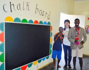 The happy painters of the chalk board at Ikwhezi Welfare Organisation