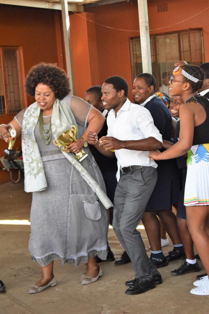 31. Mason Lincoln outside celebrating choir award (b)The Principal leads the choir in a celebratory Zulu dance.