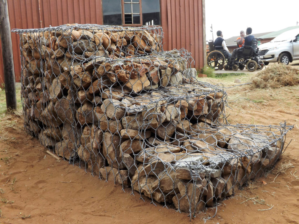 44. Mason Lincoln Steps to Success (g): The finished gabion filled with stones, approximately 3m (10 ft) long and 1.2 m (4 ft) high with four steps.