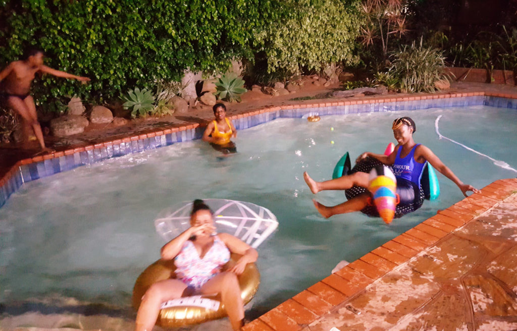 82. Braii In the pool at the Laughing Dove (b): Children and adults playing in the pool