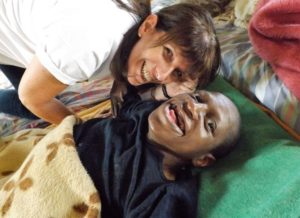 Huge smiles from Jean and one of the residents under the parachute.